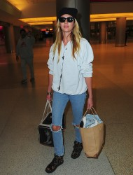 Candice Swanepoel - arrives at Miami International Airport 1/21/13