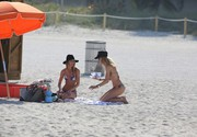 Candice Swanepoel & Doutzen Kroes - bikini candids on the beach in Miami 3/23/13