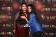 Selena Gomez and a Lucky Fan at a Meet and Greet in Seattle on November 12, 2013